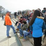 Chris giving us inside information by the foot steps of Lincoln Memorial