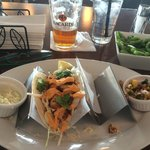 Fish tacos with sides of slaw and green beans.