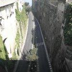 Looking at road below from bridge above. Beside restaurant.