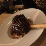 Lamb shank with pomegranate seeds at Travelle