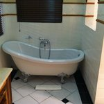 suprise bathtub in the already huge bathroom