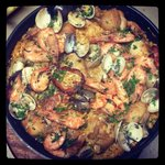 Spanish paella with chicken and seafood... by reservation