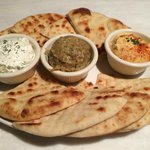 Three dips with warm pita bread