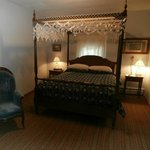 Room #1 with a lovely original queen canopy bed.
