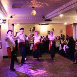 Fit Greek dancers