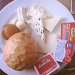Hotel breakfast: an assortment of cheeses, breads, jams