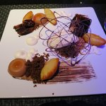 Milk chocolate and Earl Grey panna cotta, with madeleines and a scalded mlik gelato