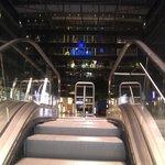 Approaching by escalator