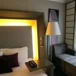 Good lighting around the bed.