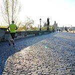 Sunrise over Prague city running