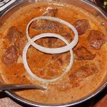 Lamb Madras Diced lamb cooked in mixture of spices and coconut flavoured sauce.