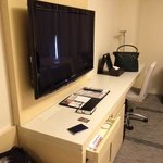 large TV with desk