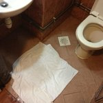 see the towel on the ground, thats where you have to take shower :(