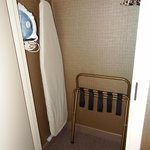 Coat closet, ironing board in our room.
