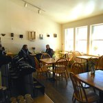 Warm and sunny seating area with monthly art exhibits