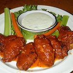 Jumbo chipotle  hot wings tossed in a sweet, smoky hot sauce with bleu cheese dipping sauce