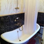Old style free standing bath with shower
