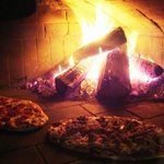 Pizzas in the brick oven