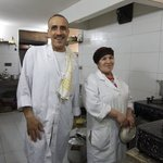 Owner Touzani & cook in his kitchen
