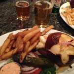 Pretzel bun burger with fat fries and hangover sauce on the side