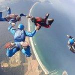 Visitors do tandem jumps and regular jumpers do stuff