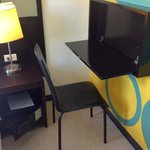 Thumbs up for the fold away desk.  Don't know about the bold wall colors.