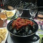 "An example of bad ""moules frites"" in Provance sauce, with small stones in pot !"