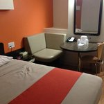 Corner table and sitting area,  Motel 6 Winnipeg West  |  4400 Portage Avenue, Headingley, Manit
