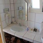 Bathroom needs updating (note home brand liquid soap)