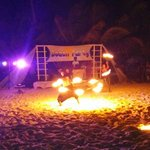 Fire juggling at the beach party