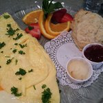Three cheese omelet with homemade biscuit & honey butter