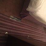 Tape holding carpet together in room