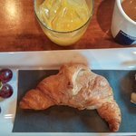 Complimentary breakfast of warm croissant, Brie cheese and fruit.