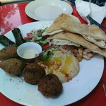 Platter with vine leaves, falafel, shawerma chicken and kibbeh