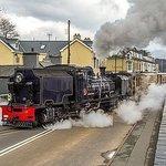 Beyer-Garratt locomotive number 87 crosses the High Street at Porthmadog with the morning train