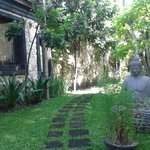 the garden is filled with Balinese huts and beautiful landscaping