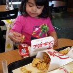 Daughter having some chicken nuggets with waffle fries