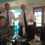 Wayne and staff serving desert