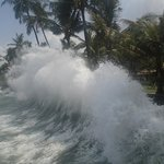 Waves crash every afternoon against the wall surrounding the resort