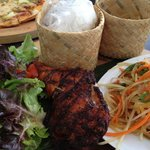 BBQ Chicken served with som-tum and sticky rice