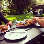 At a picnic bench on the lawn to eat our Weighbridge Platter & enjoy a glass of their gorgeous r