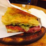 Salami, mozzarella, Sun Dried Tomatoes, and pesto sauce. Absolutely mouth watering!