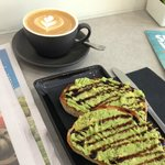 My flat white and avo toast. Not the best photo sorry. The bread is sourdough. It has balsamic g