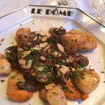A delicious serving of scallops with liver.