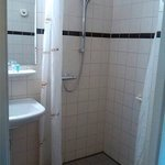 small, dismal, greyish bathroom only without the bath