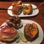 Angus burger and salmon sandwich with baked potato