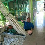 Phil chillin in the hammock by the beautiful mosaics that Jacki did herself.