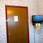 Door and the little tv in the room.