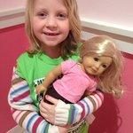 Her doll's newly pierced ears.