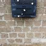 Plaque at Sachsenhausen concentration camp commemorating homosexual victims.